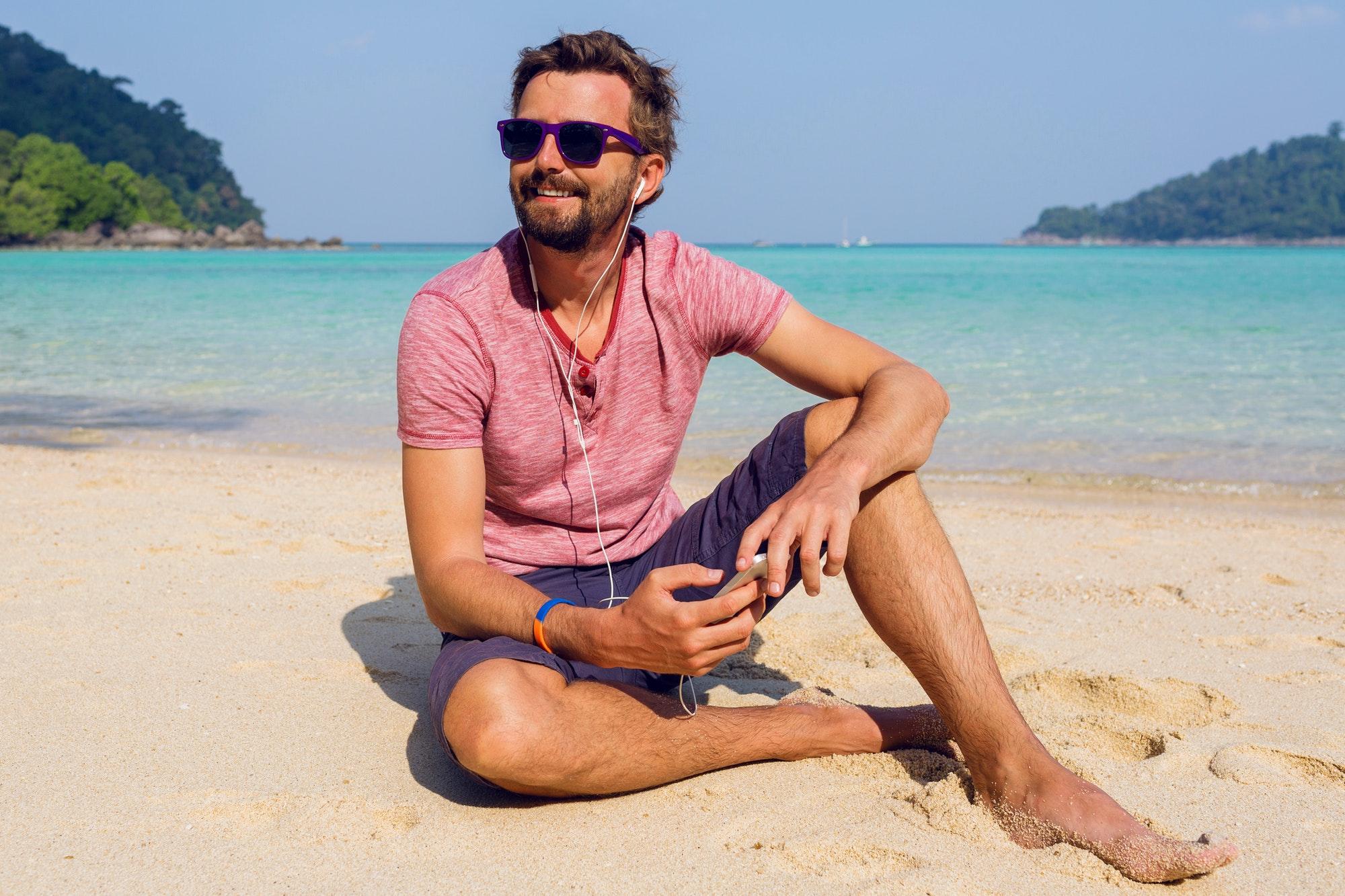 Attractive man man in stylish sunglasses with beard