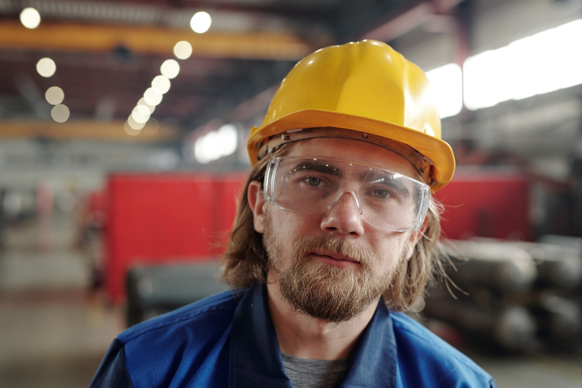 Portrait of factory man in goggles