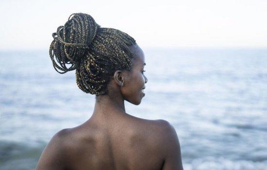 African woman having fun at beach
